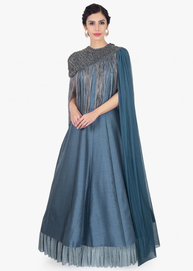 Pigeon blue silk gown with matching lycra cape with embellished neckline only on Kalki