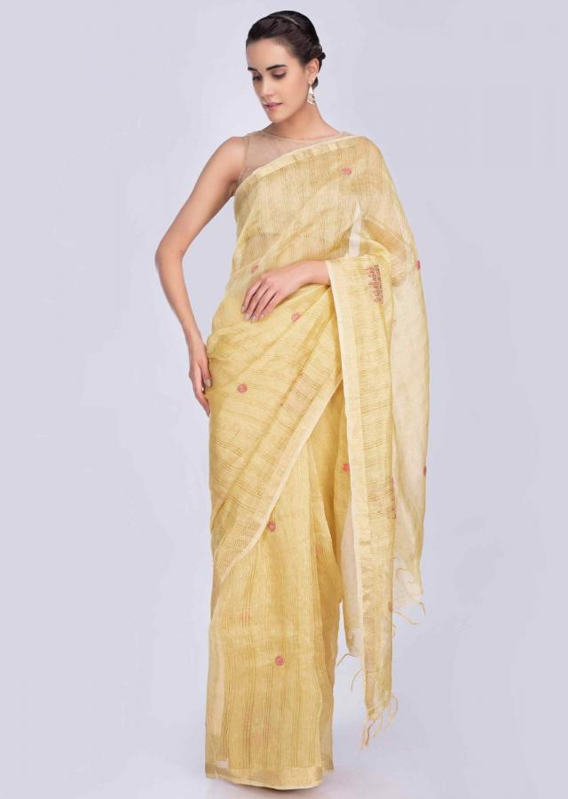 Pine yellow linen saree with embrodered butti in abstract motif only on Kalki