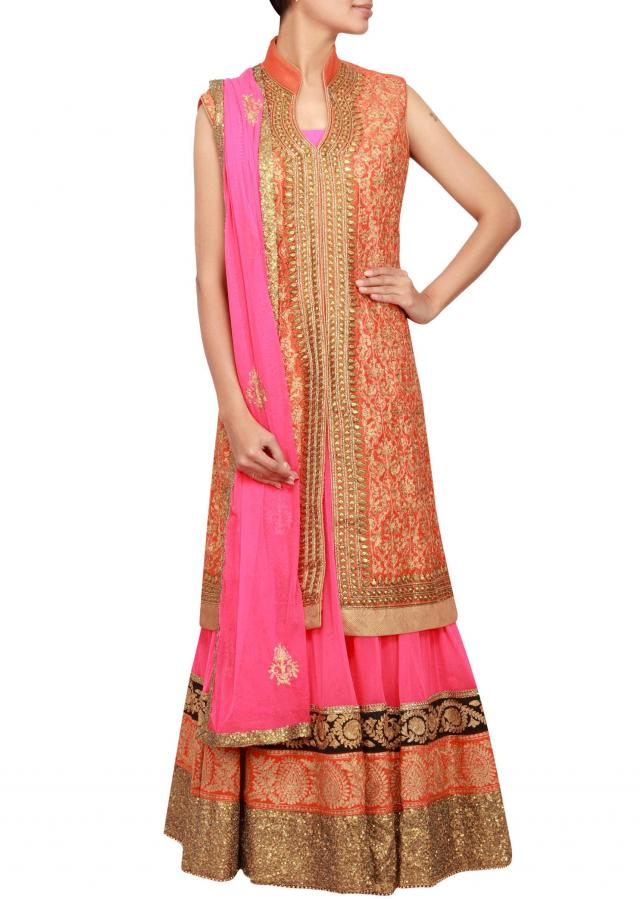 Pink anarkali suit matched with orange jacket embroidered in zari and sequence embroidery only on Kalki