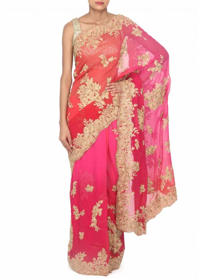 Bubblegum coral saree adorn in zari and kardana in floral only on Kalki