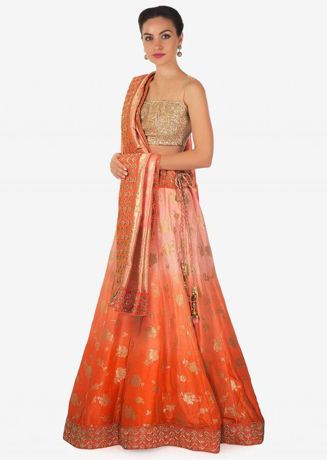 Pink and peach shaded lehenga set in brocade adorn in zari and kundan border only on Kalki