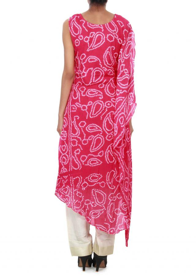 Pink bandhani suit enhanced in cowl drape only on Kalki