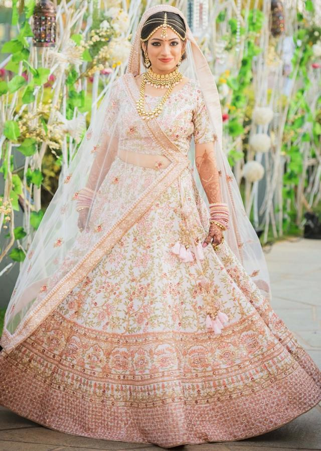 Pink cream lehenga adorn in floral embroidered jaal only on Kalki