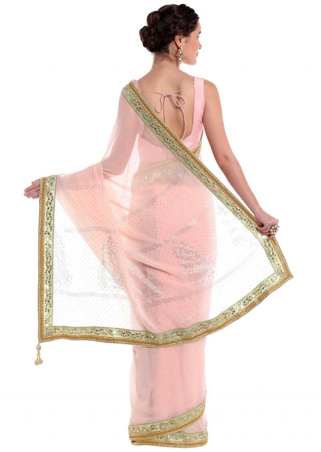 Pink georgette saree styled with gotta patch embroidery  only on Kalki