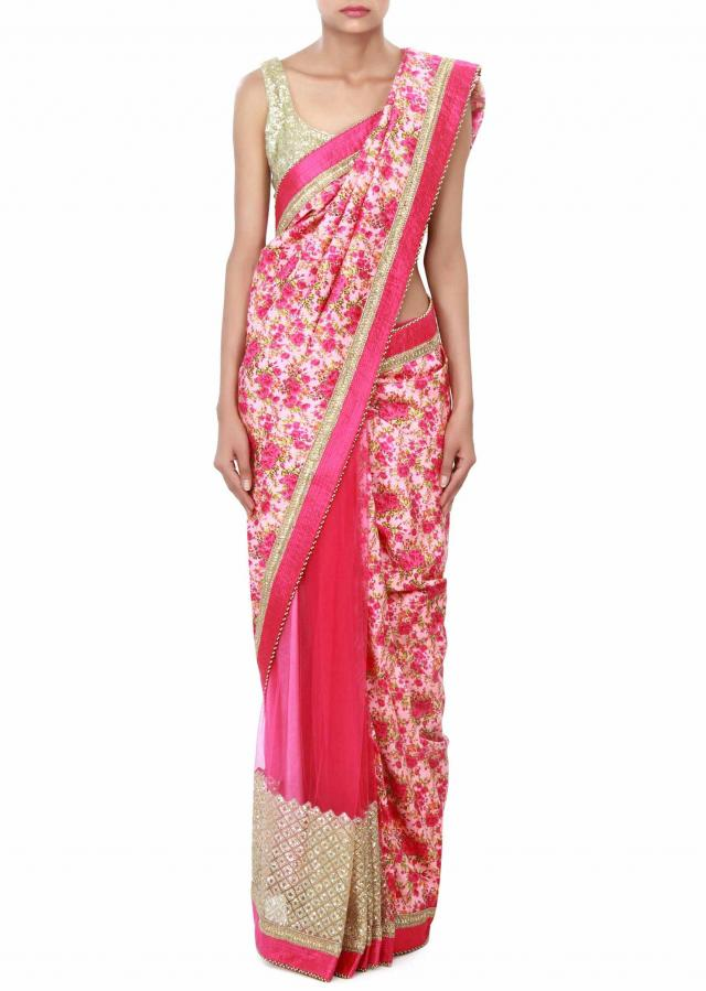 Pink half and half saree enhanced in print and embroidered border only on Kalki