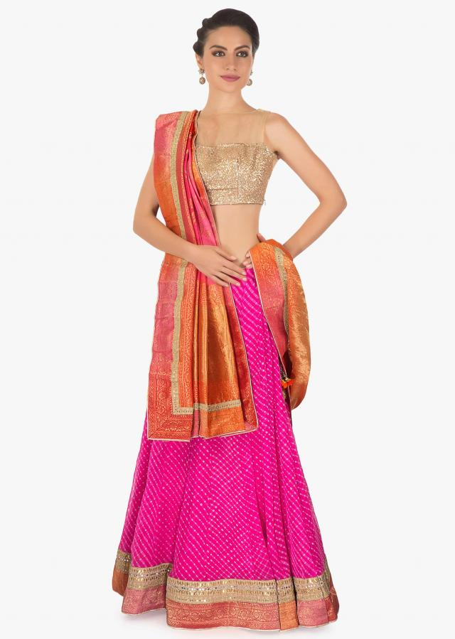 Pink leherie georgette lehenga matched with shaded brocade dupatta
