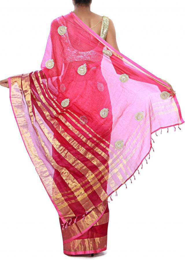 Pink saree adorn in gold border and kundan butti. only on Kalki