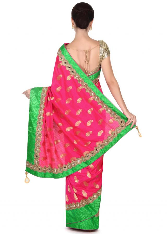 Fuchsia pink saree adorn in green bandhani printed border only on Kalki