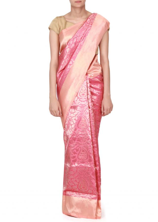 Pink saree features with peach border only on Kalki