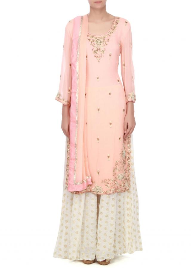Pink straight suit adorn in pearl and zardosi only on Kalki