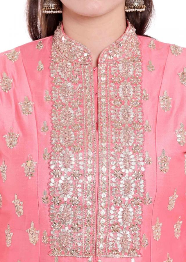 Pink suit with front slit in gotta patch embroidered placket