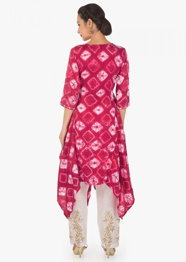 Pink and off white tunic in batik print matched with off white  gotta patch work pants only on Kalki