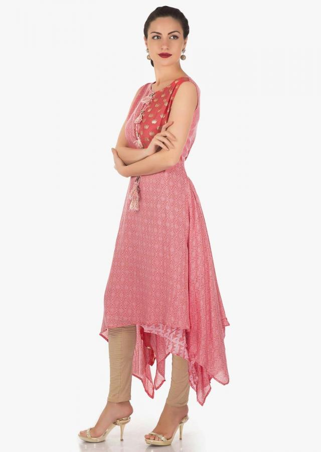 Pink kurti in self and foil print in lotus motif along with fancy tassel only on Kalki