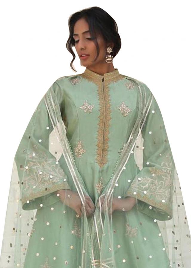 Pista green chanderi suit matched with silk sharara