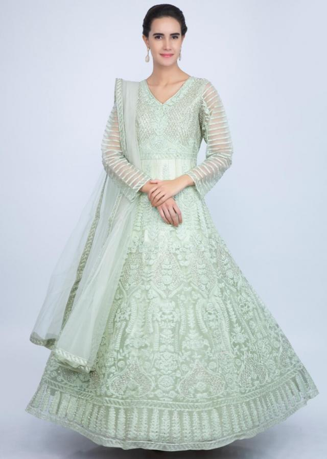 Pista green heavy embroidered net anarkali in floral and jaal embrodiery only on Kalki