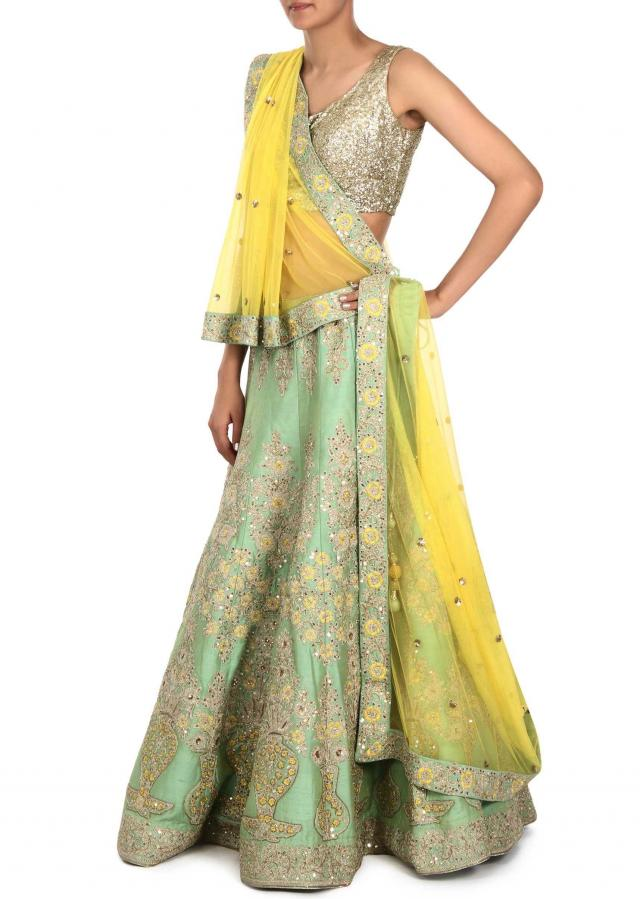 Pista green lehenga adorn in zari and resham embroidery only on Kalki