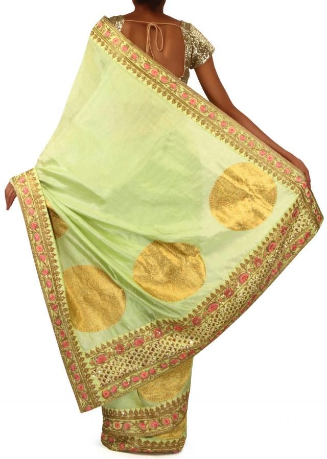 ‌Muted Green Saree Embellished In Weave And Sequin Border Online - Kalki Fashion