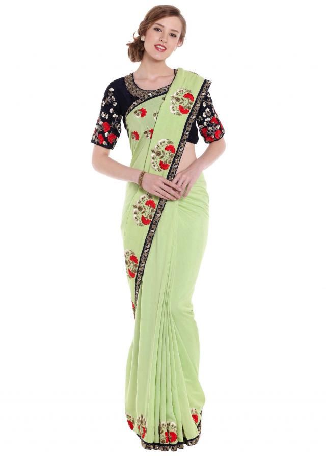 Pista green saree with border adorn in embroidered butti only on Kalki