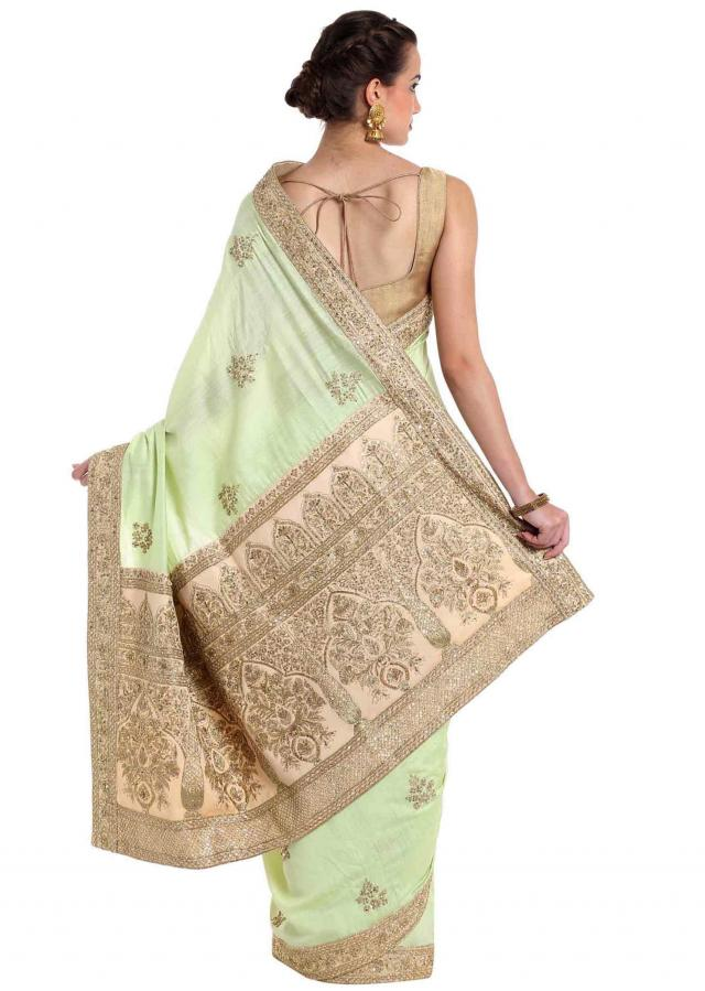 Pista green silk saree adorned with zari and sequins only on Kalki