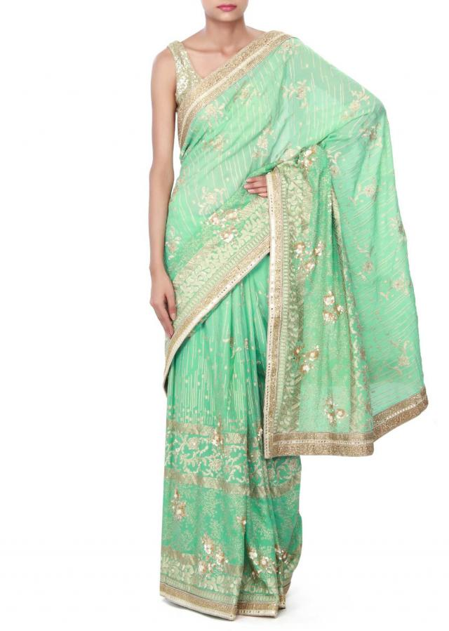 Pista green unstitched suit enhanced in resham and sequin embroidery only on Kalki
