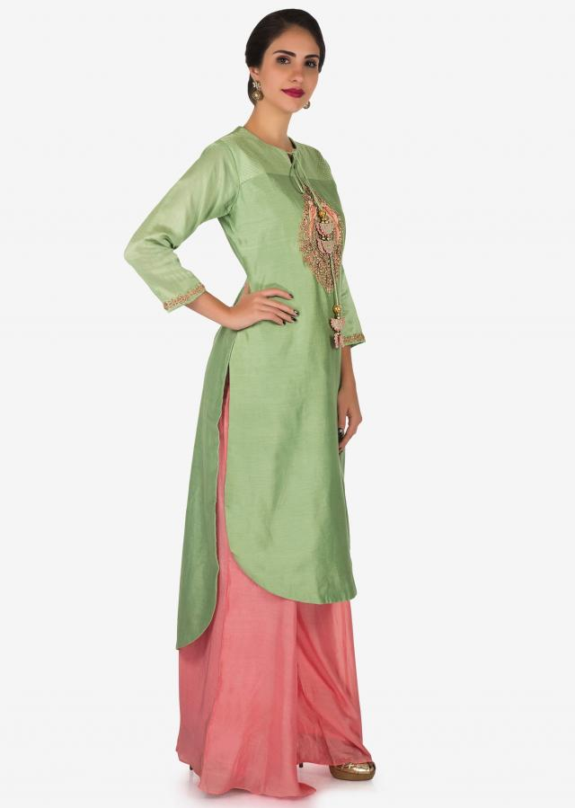 Pista green  and pink palazzo suit beautified in zardosi embroidered work only on Kalki