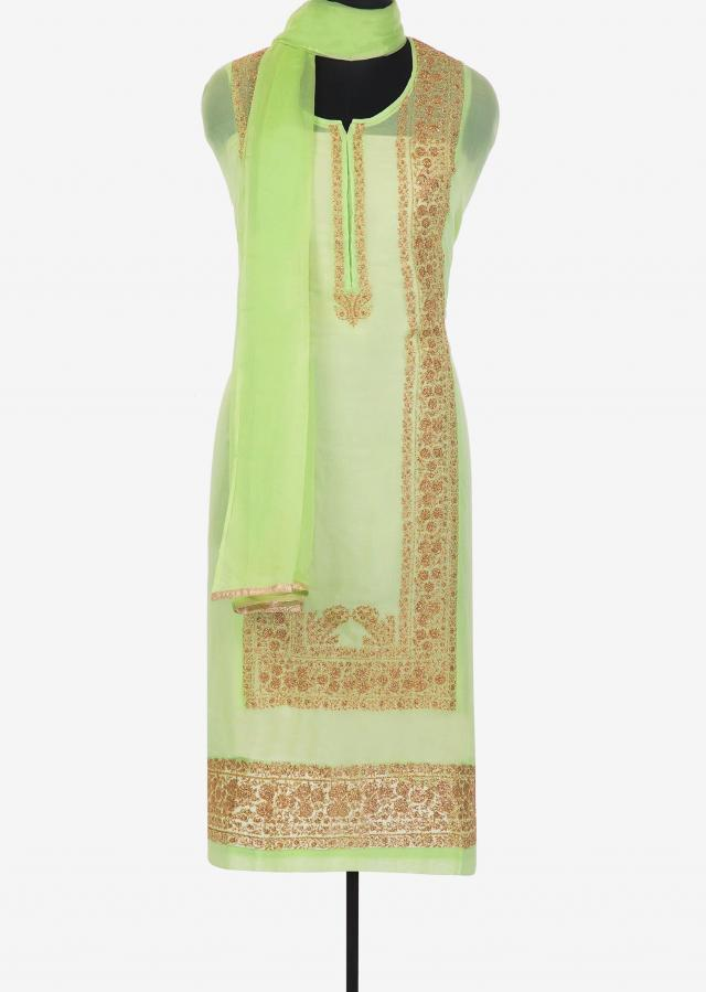 Pista green semi stitched suit with zari embroidery in center panel only on Kalki