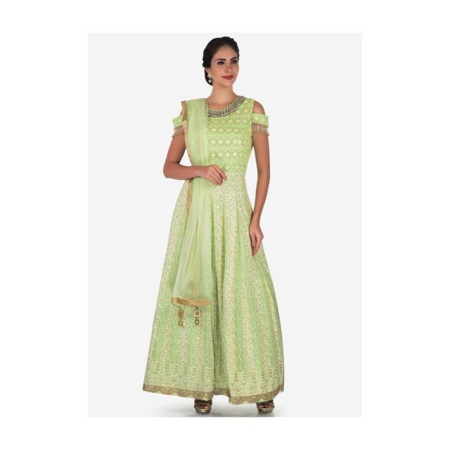 Pista green suit in georgette embellished in heavy stone and tassel embroidery work only on Kalki