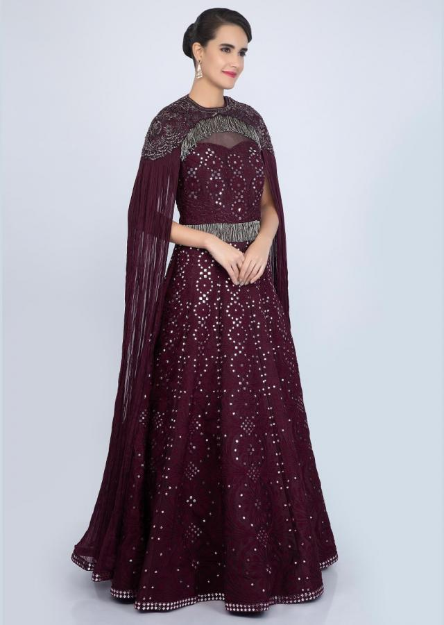 Plum cord embroidered gown with shoulder cape and flared sleeves only on Kalki