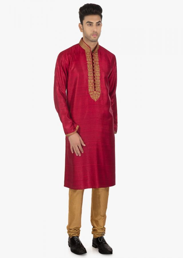 Poinsettia Red  silk kurta with a contrasting collar and sleeves matched with a Sandal Brown chudidar set only on Kalki