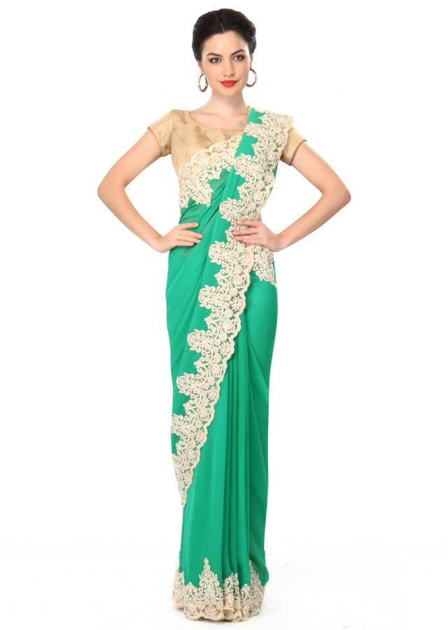 Pool green saree featuring with thread embroidered border only on Kalki