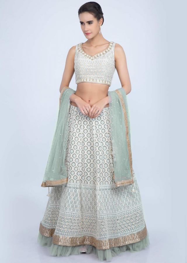 Powder grey thread embroidered lehenga set with net ruching at the hem only on Kalki