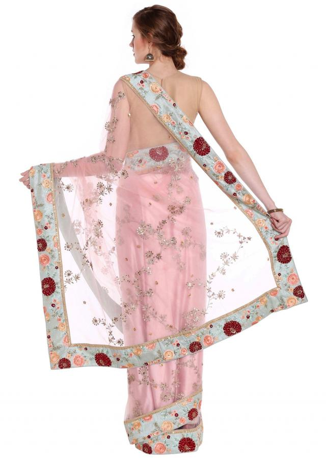 Powder pink saree with floral embroidered border only on Kalki