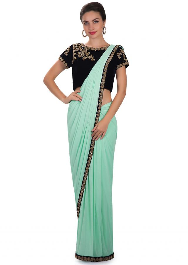 Pre stitched saree in pista green with embroidered blouseonly on Kalki