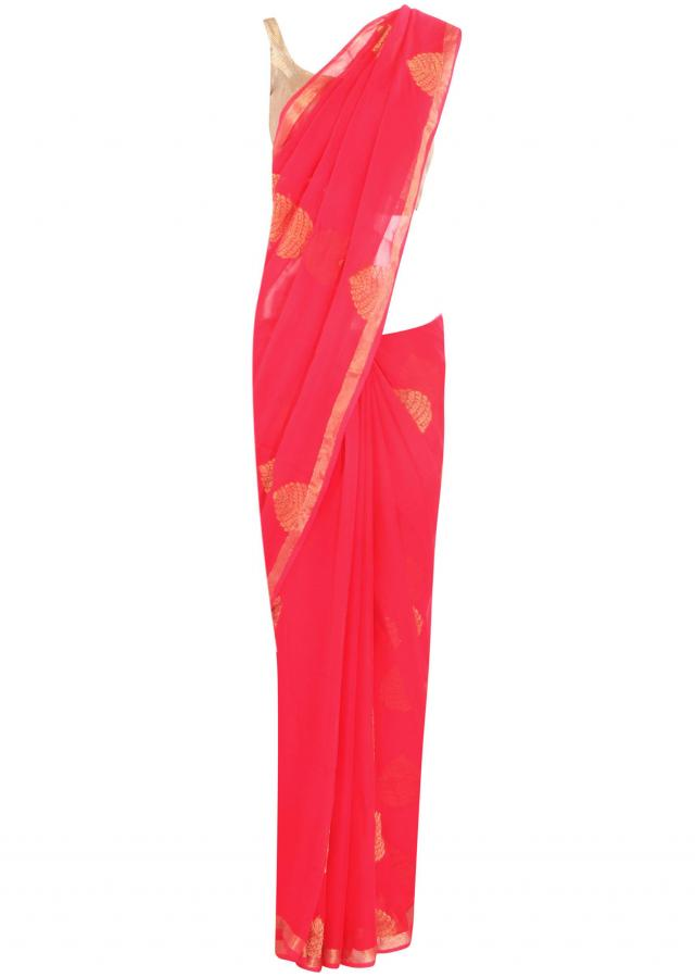 Rani pink saree adorn in weaved embroidery only on Kalki