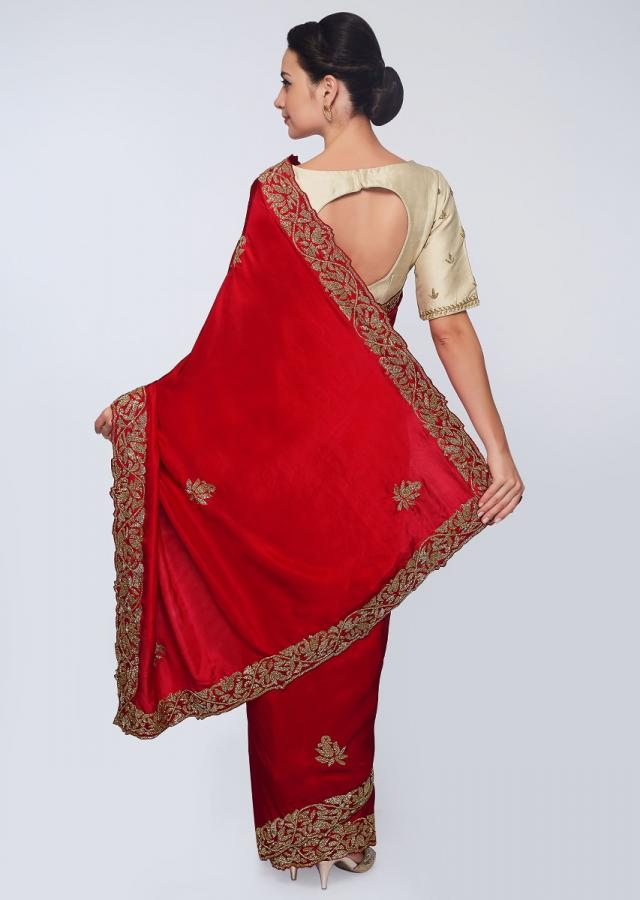 Rani pink satin saree embellished with cut dana embroidered butti and border only on Kalki