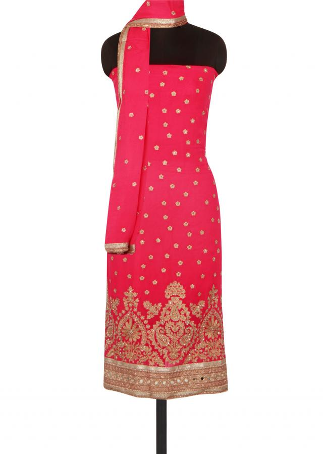 Rani pink unstitched suit adorn in zari embroidery only on Kalki