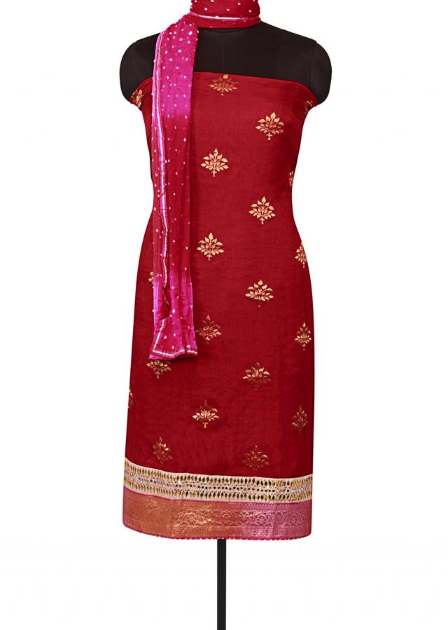 Rani pink unstitched suit with shaded bandhani dupatta only on Kalki