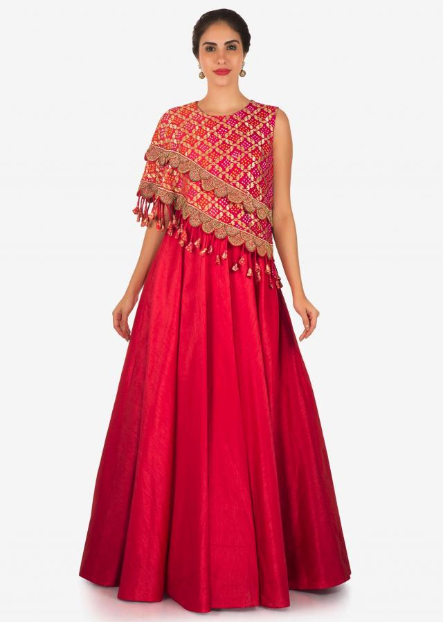 Rani pink anarkali gown with fancy bodice highlighted in lace and tassel only on Kalki