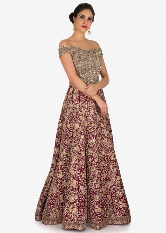 Rani pink gown in silk heavily embellished in resham, moti and zari embroidery only on Kalki