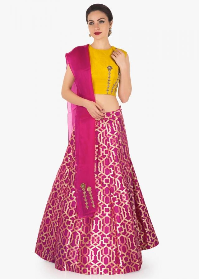 Rani pink lehenga in brocade silk with contrast yellow raw silk blouse in zardosi work only on Kalki