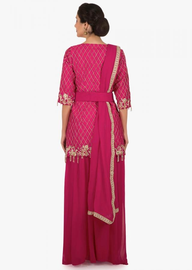 Rani pink palazzo suit beautified in resham and embroidered tassel embroidered work only on Kalki