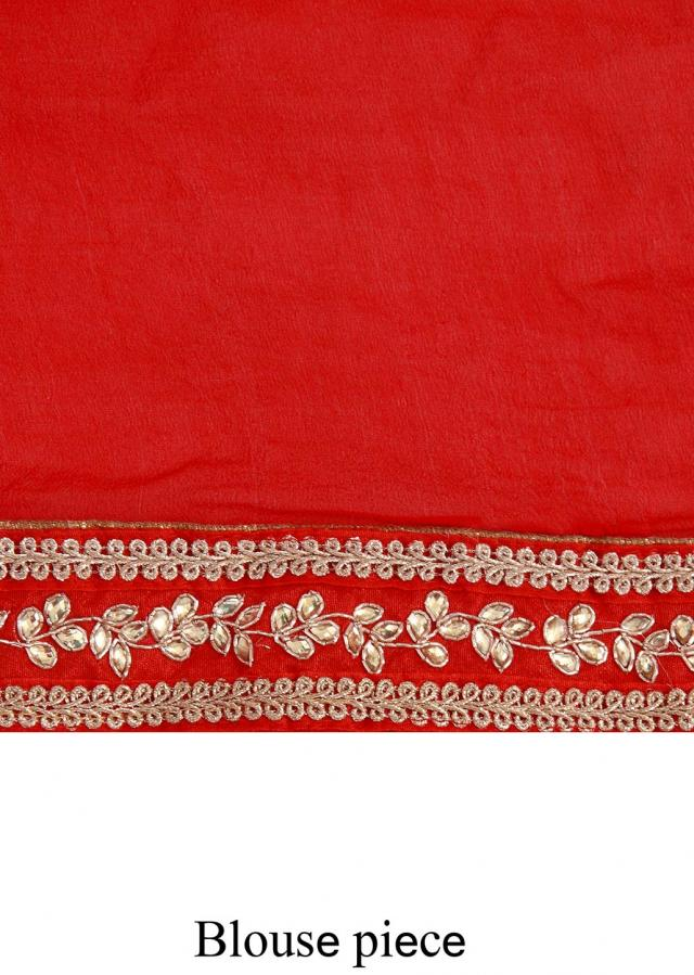 Red bandhani saree adorn in zardosi cut work only on Kalki