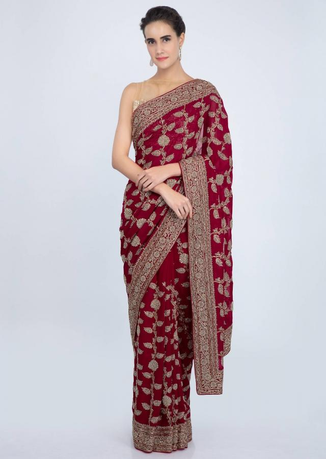 Red georgette saree in heavy embroidered butti and border only on kalki