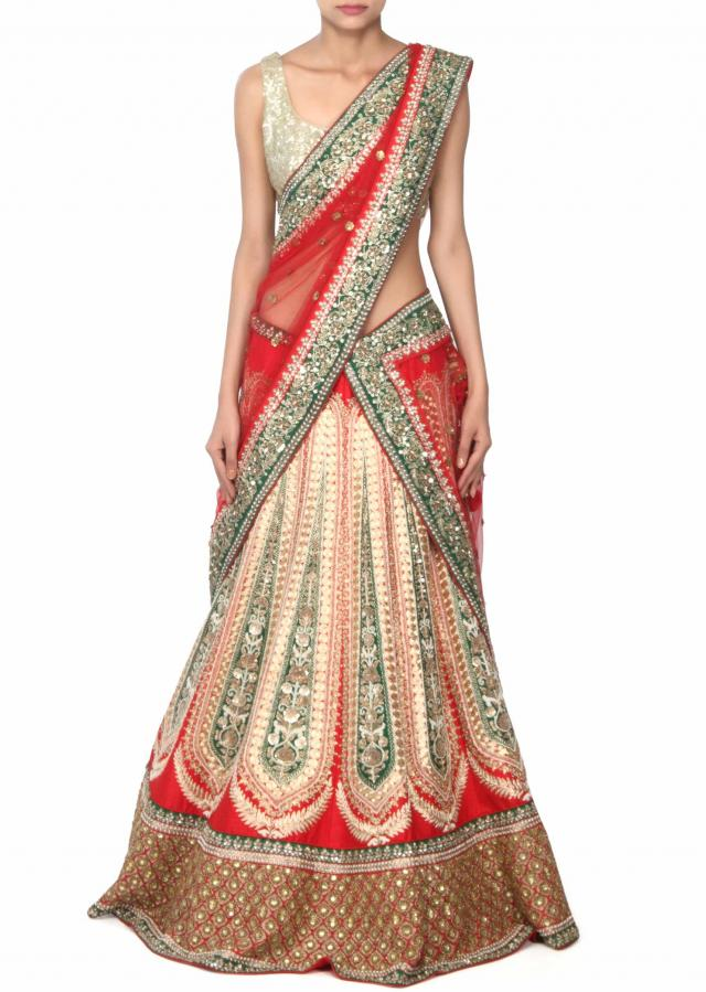 Red lehenga adorn in pearl and zari embroidery only on Kalki