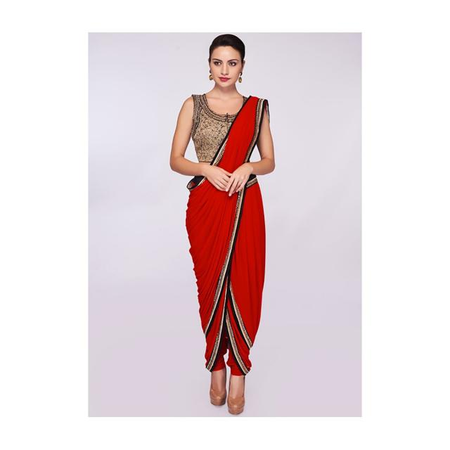 Red lycra dhoti saree paired with fancy fabric blouse only on Kalki