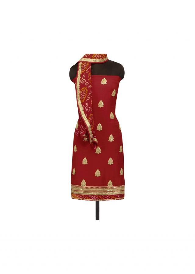 Red unstithced suit adorn in zari and sequin butti only on Kalki