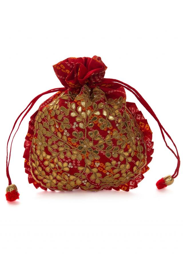 Red bandhani potli bag beautified in gotta patti embroidered work only on Kalki
