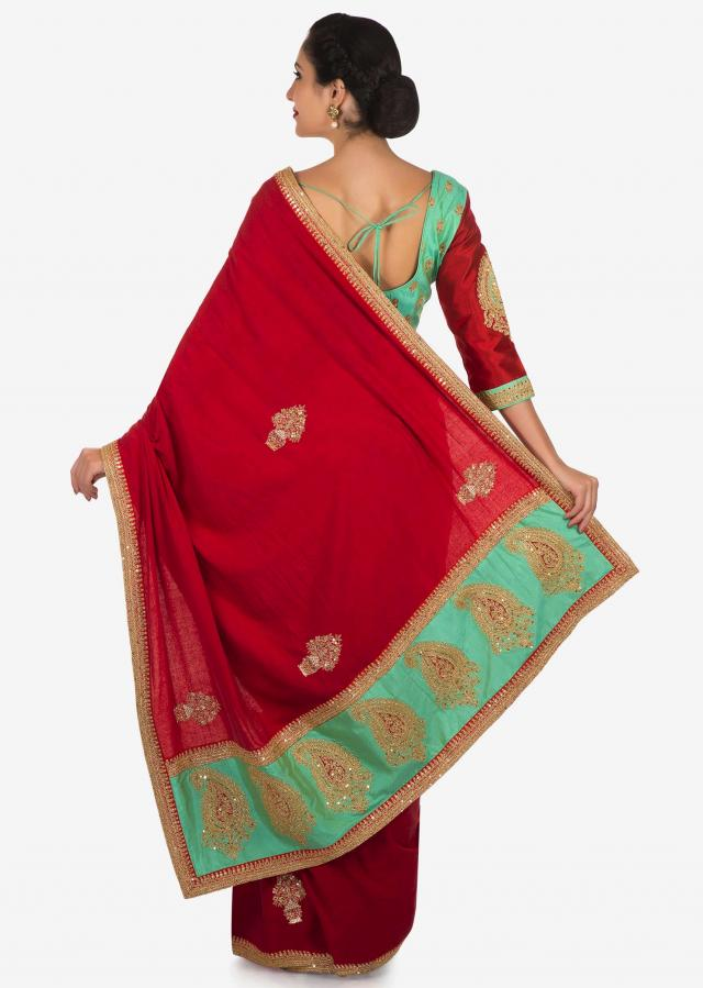 Red saree in cotton with ready stitched blouse embellished in zari butti embroidery only on Kalki