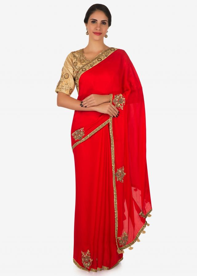 Red saree with beige blouse embellished in zardosi and frenchknot butti work only on Kalki