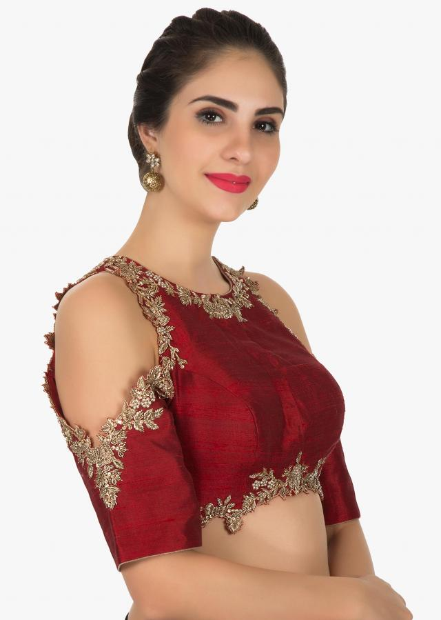 Red stitched blouse enhanced in zardosi and sequin work only on Kalki